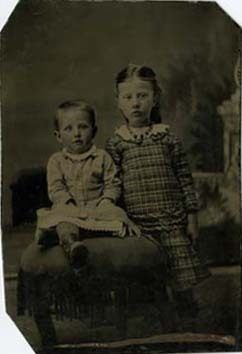 Two Children in Dresses