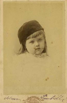 Alma Trumbull Wearing Dark Hat