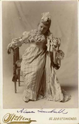 Alma Trumbull in a Striped Dress